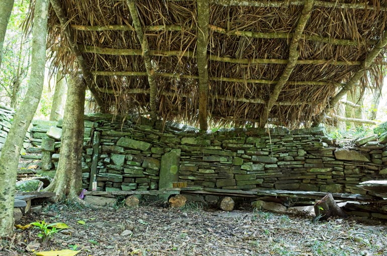 Stone wall with thatched roof