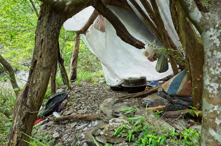 View inside makeshift camp - random items strewn about