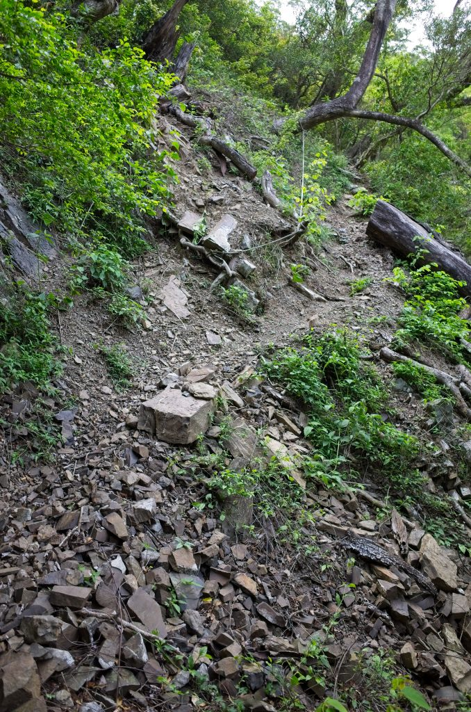 Loose rocky incline with rope