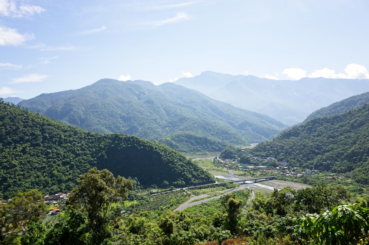 Looking down at Danling - Mountains in background - river in middle