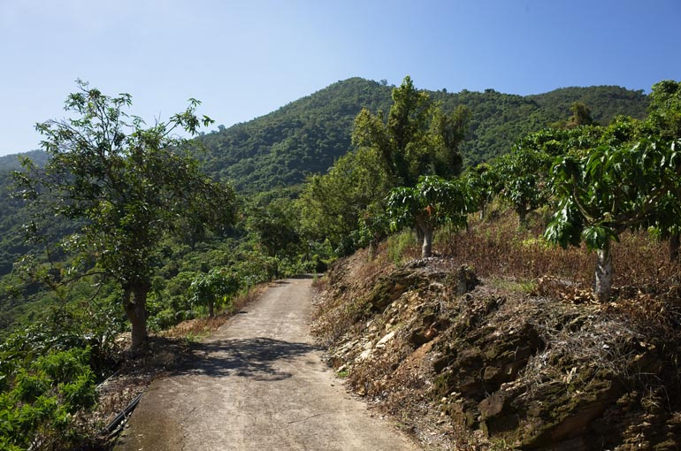 Old mountain concrete road - mountains in background