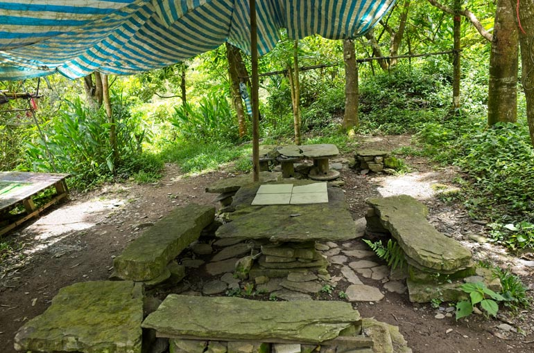 Inside the cleared area - better view of the stacked stone tables and chairs